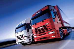 Two lorries driving down a road