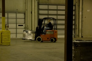 forklift truck picking up objects