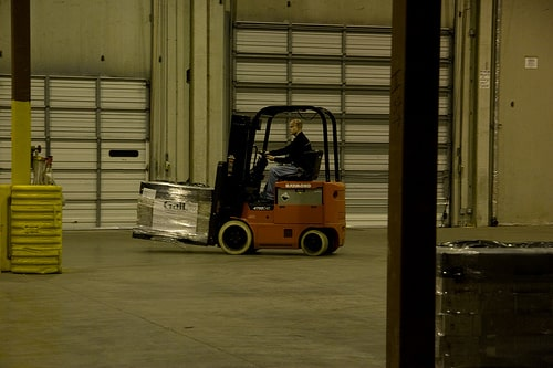 forklift truck driver picking up objects